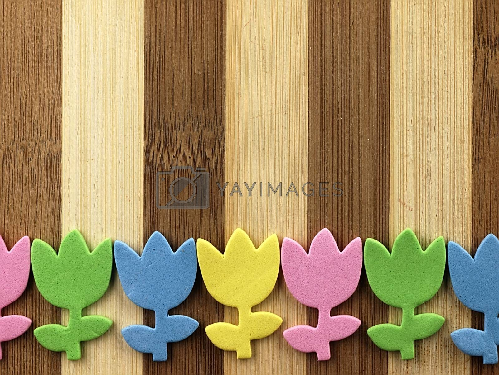 Royalty free image of Colorful cut tulips on a chopping board. by kamiwro