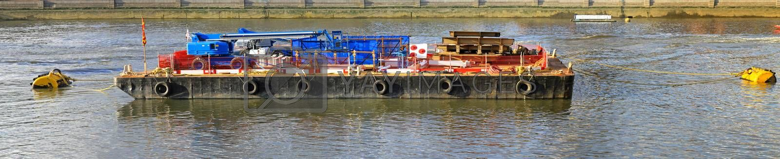 Barge with construction tools on Thames river