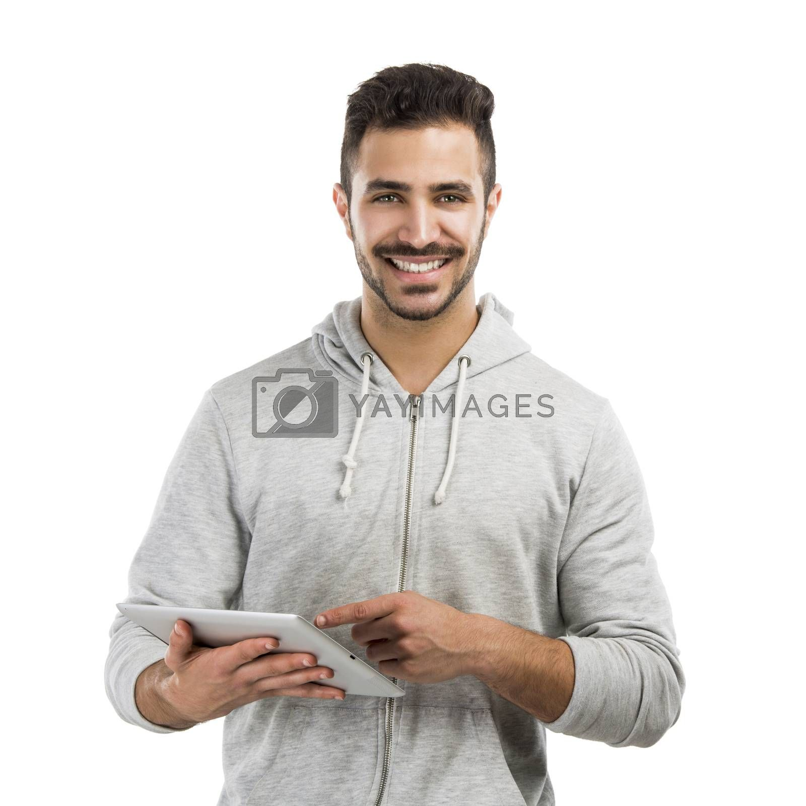 Good looking latin man working with a tablet