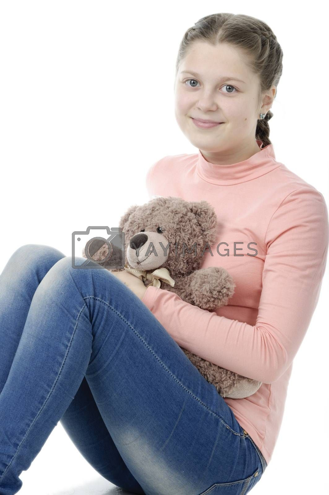 Portrait of pretty little girl holding teddy bear isolated on white