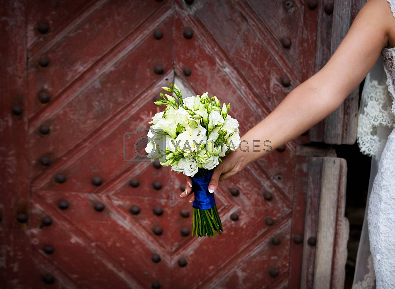 Royalty free image of Bride holding beautiful wedding flowers bouquet by sfinks