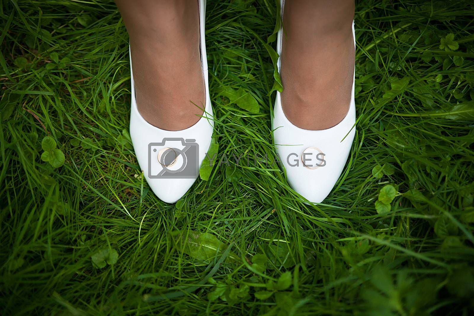 Royalty free image of Wedding sandals and weddings  rings by sfinks