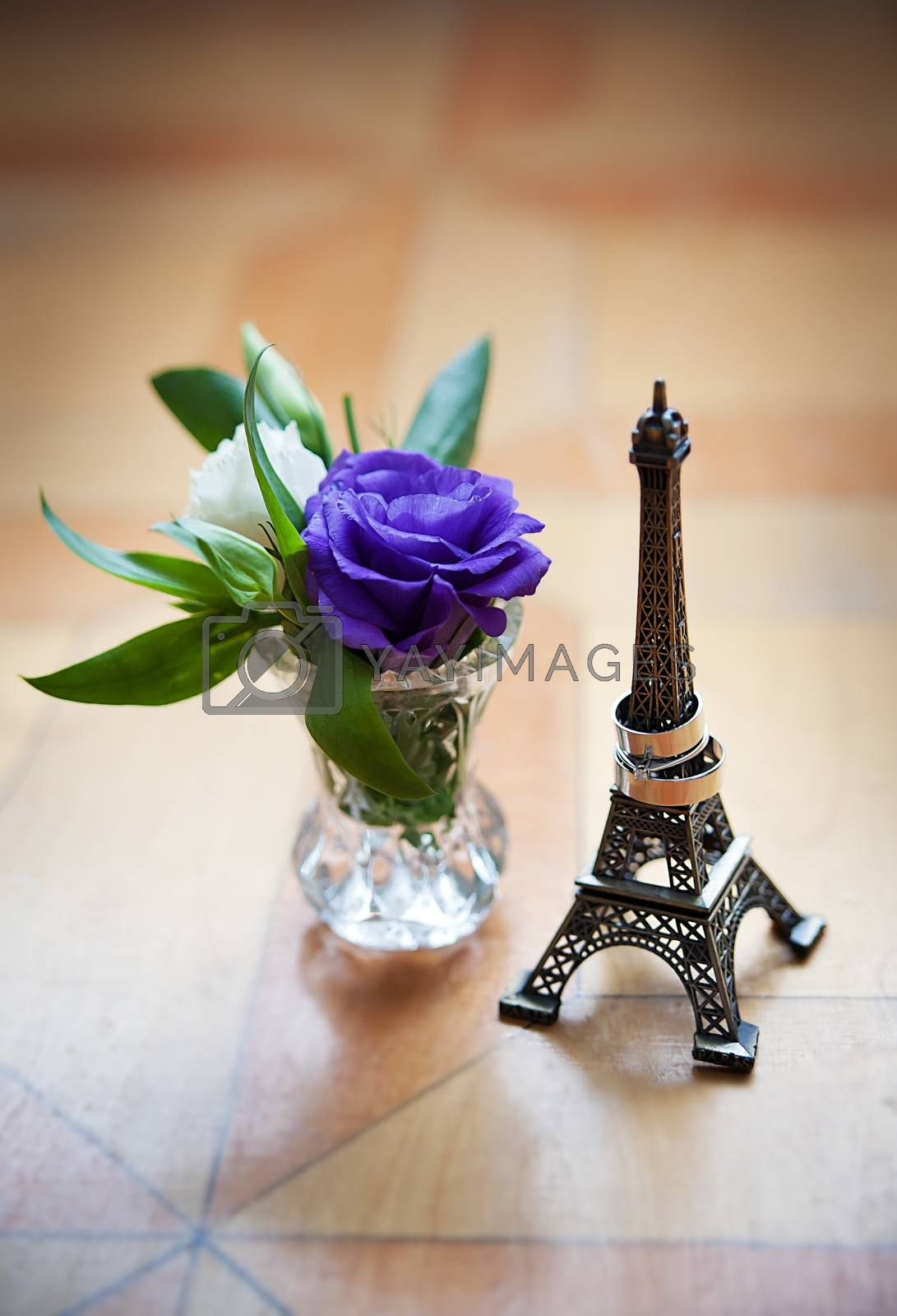 Royalty free image of statuette of Eiffel Tower and wedding rings by sfinks
