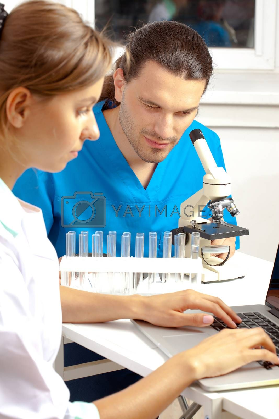 two scientists conduct scientific research in a lab