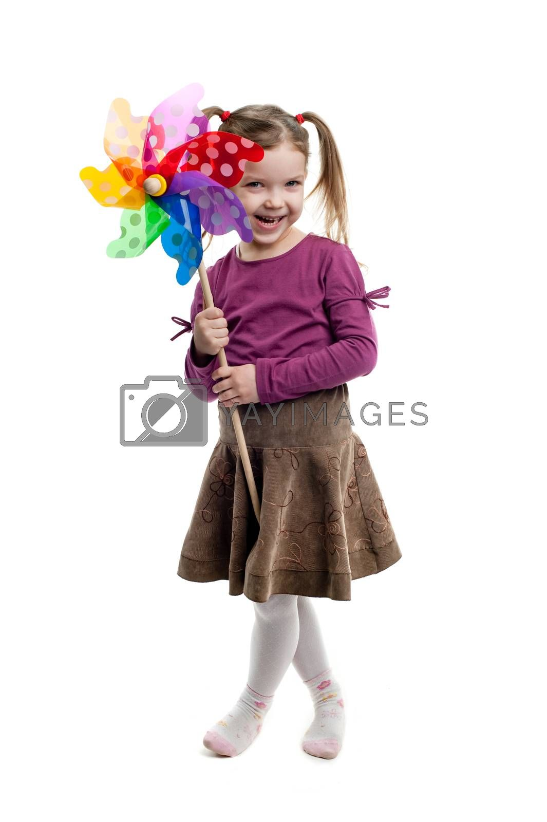 Little girl holding colorful windmill isolated on white