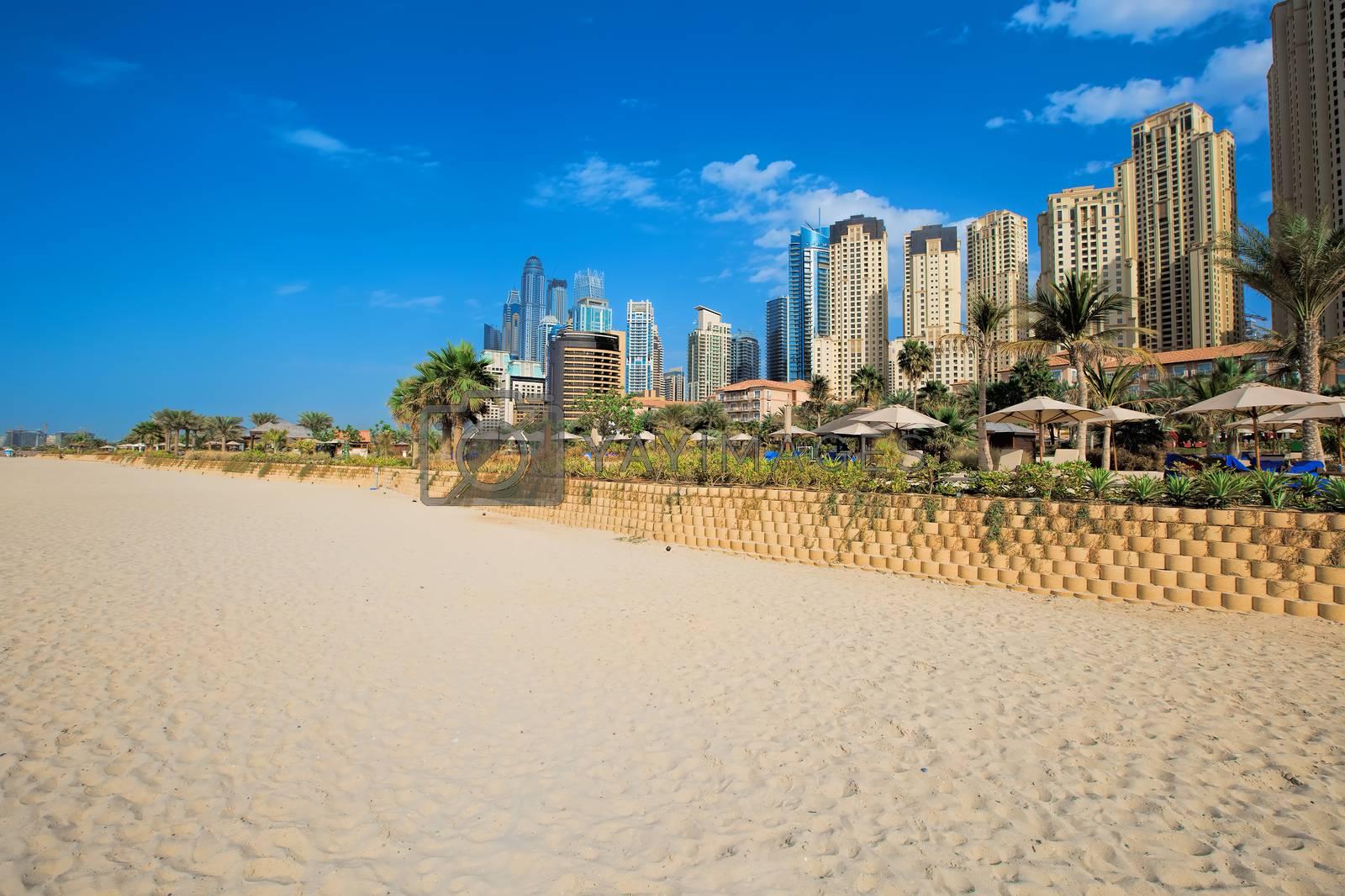 Beach and skyscrapers at Jumeirah beach in Dubai marina