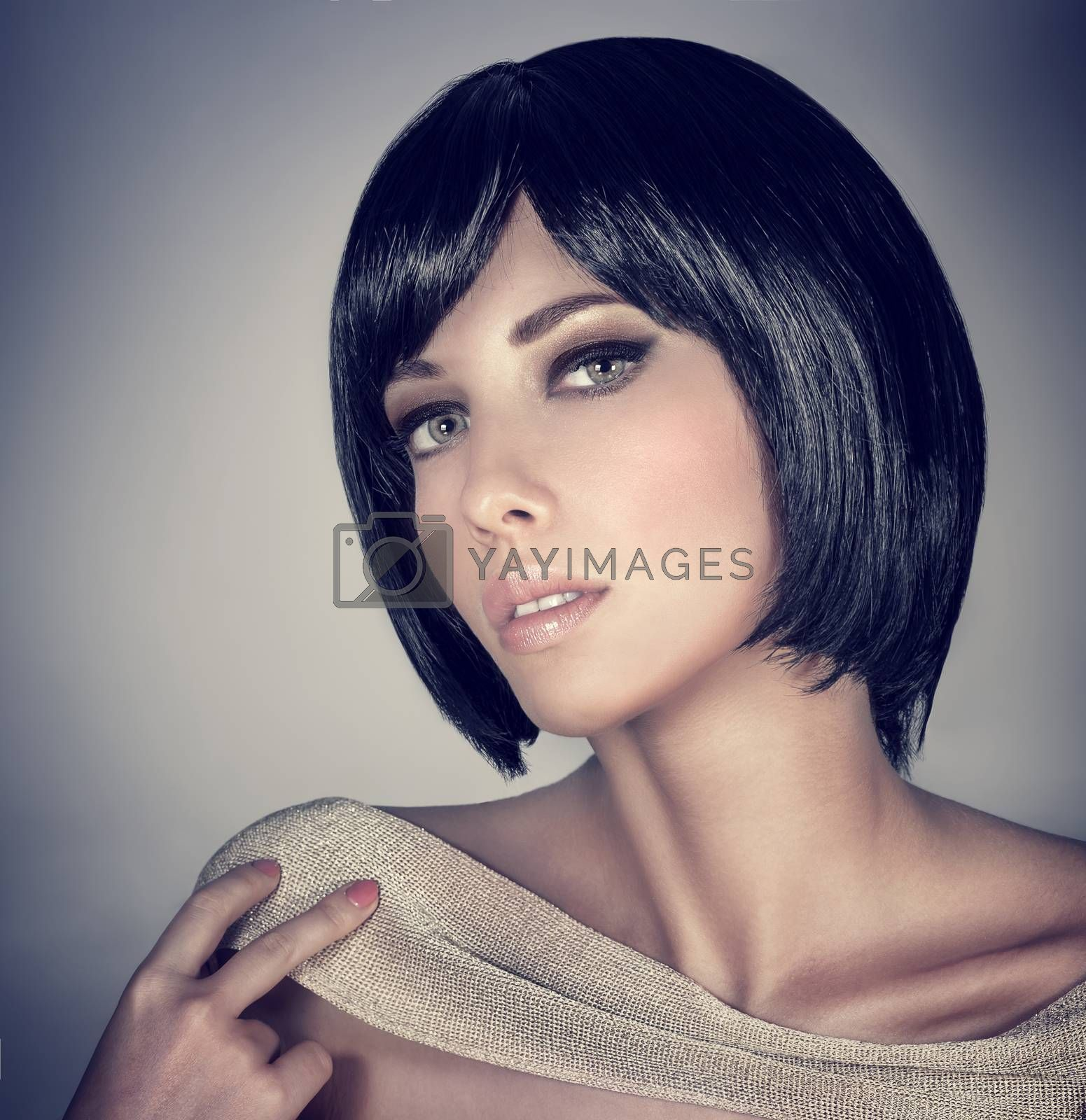Closeup portrait of beautiful brunette female with stylish short haircut and makeup isolated on gray background, fashion and beauty concept