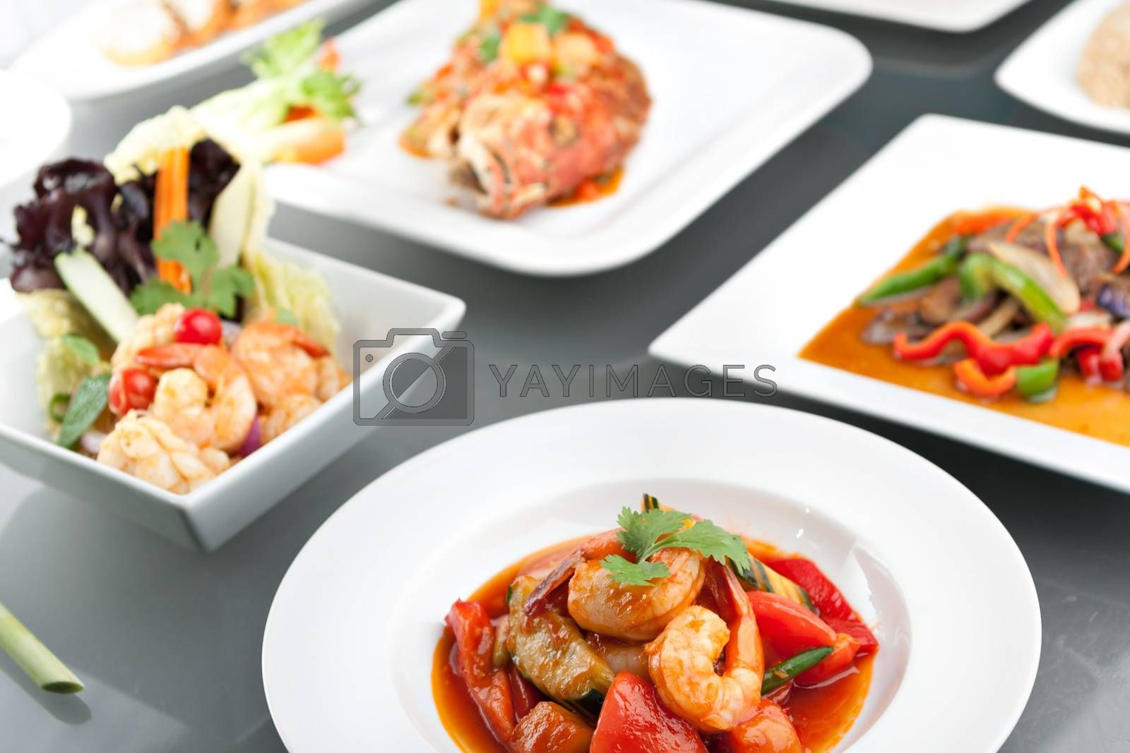 Variety of Thai style whole fish red snapper sweet and sour shrimp gyoza dumplings sesame breads seafood salad and other spicy Thai dishes.