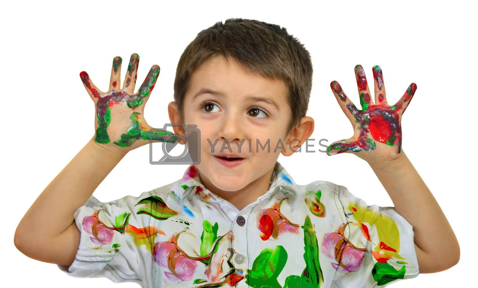 Little boy painting with hands with different color paint on his palms