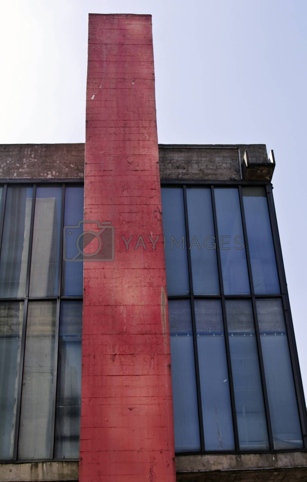 Modern building with glass facade in blue and red