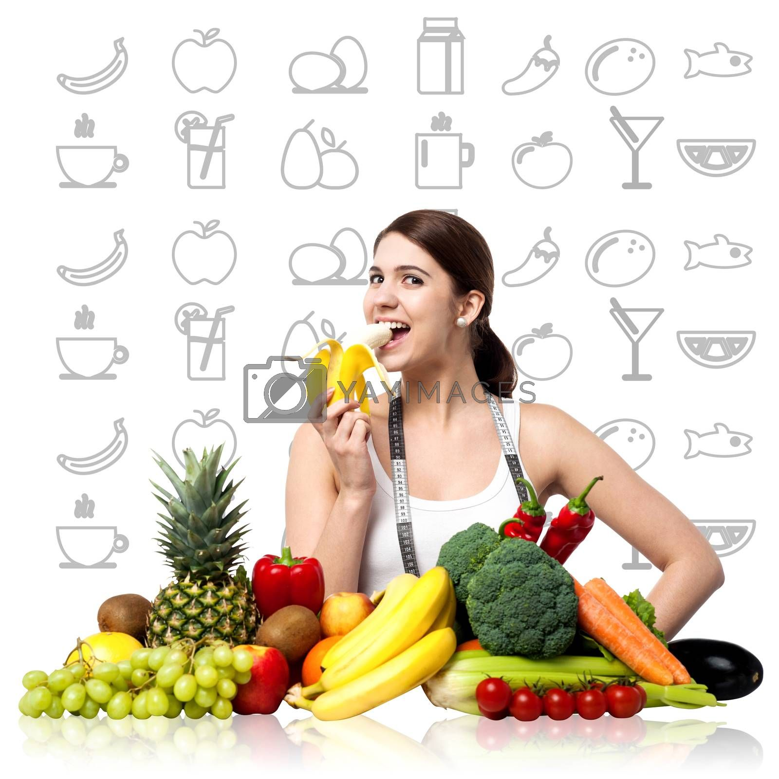 Young woman eating banana, stay fit