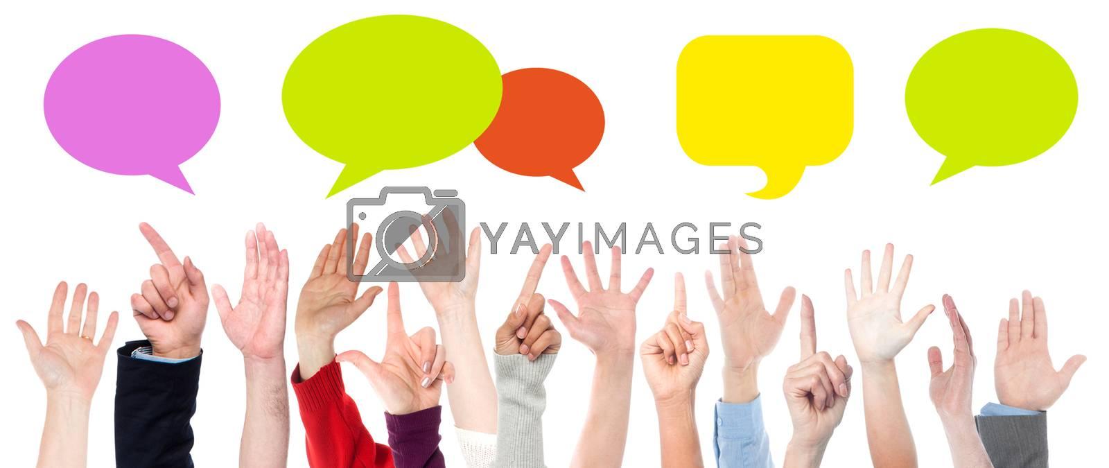 Hands raised up. Colorful speech bubbles.