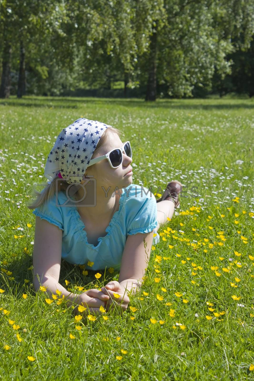 Royalty free image of little girl lying on grass  by miradrozdowski