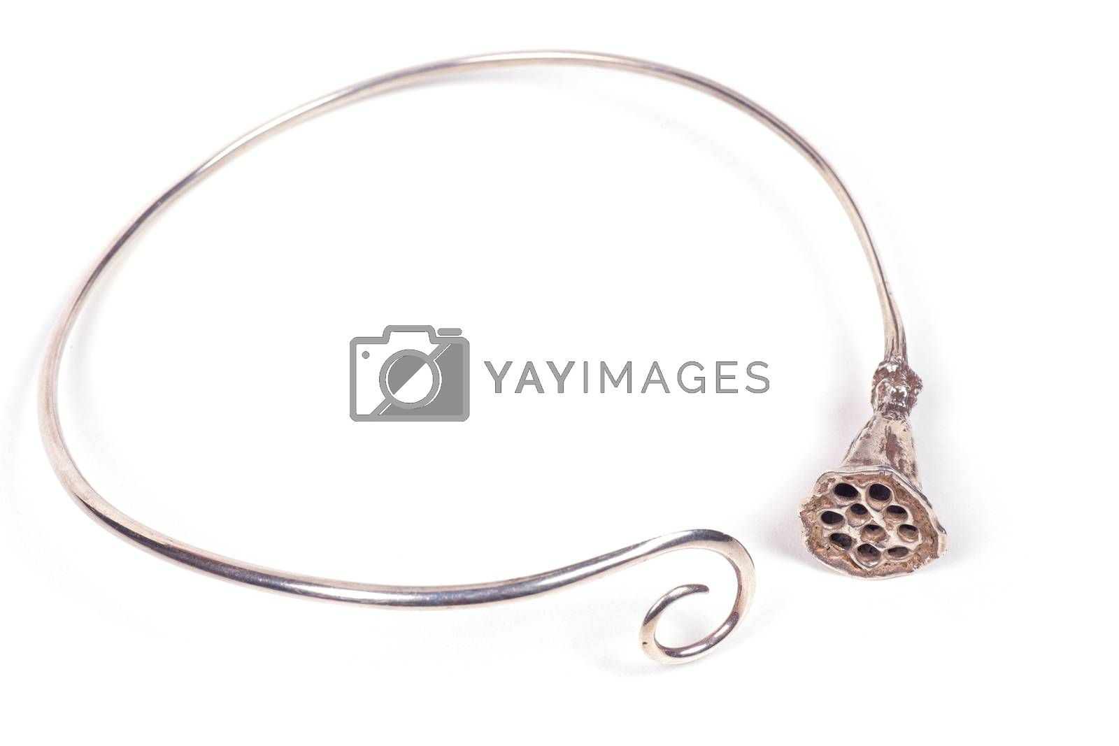 Close up of silver necklace isolated on white background, manufactured by Ornella Salamone