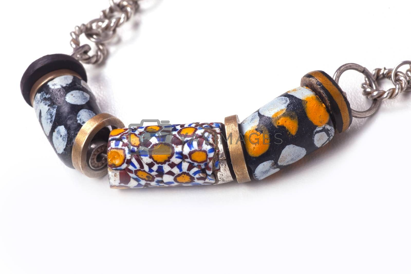 Close up of silver and painted stone necklace by bepsimage