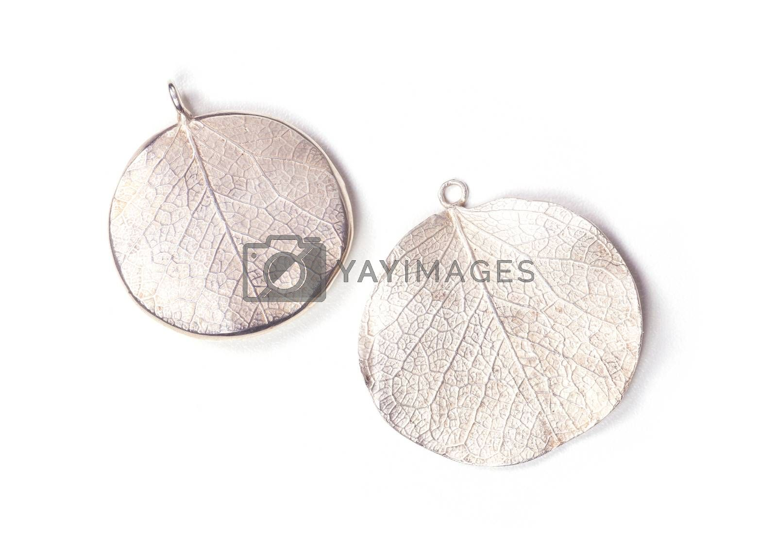 Close up of silver earrings isolated on white background manufactured by Ornella Salamone