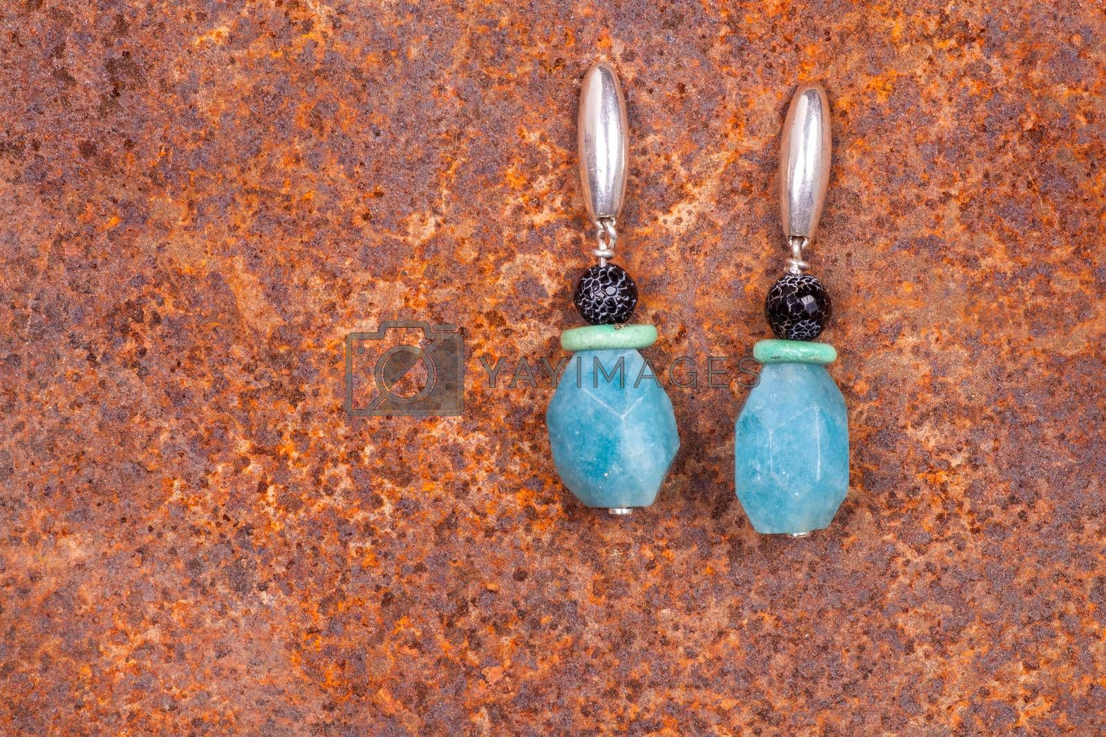 Close up of chalcedony earrings by bepsimage