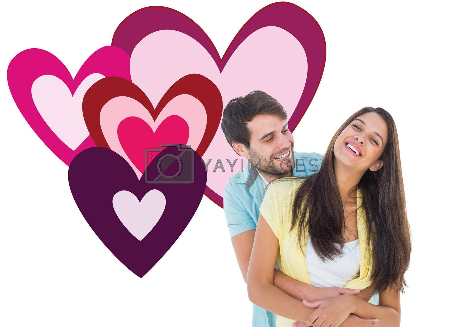 Happy casual couple smiling and hugging against valentines love hearts