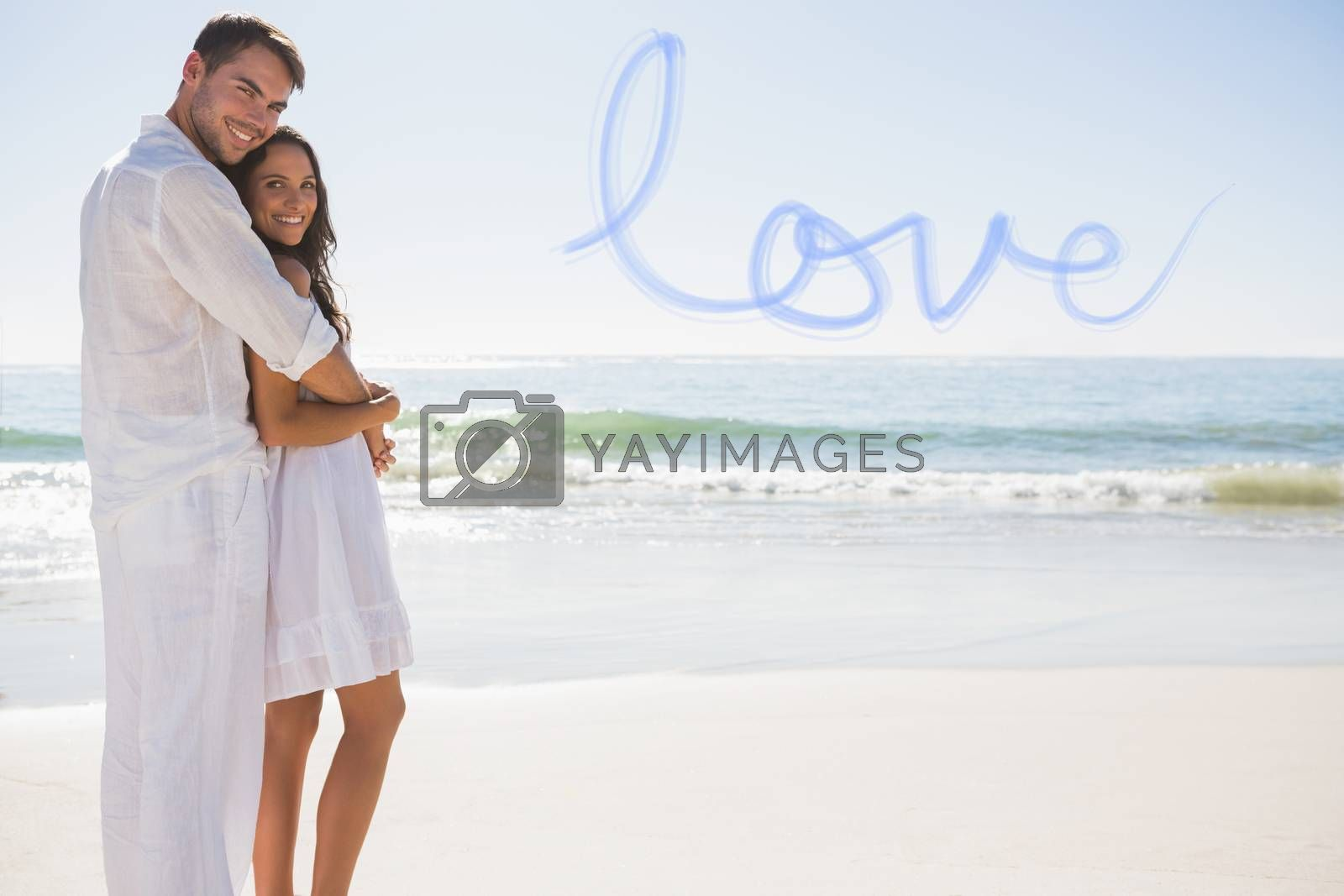 Attractive couple hugging and looking at camera against love
