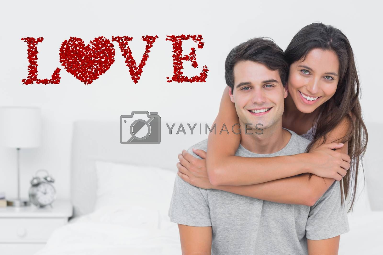 Woman embracing her partner against love spelled out in petals