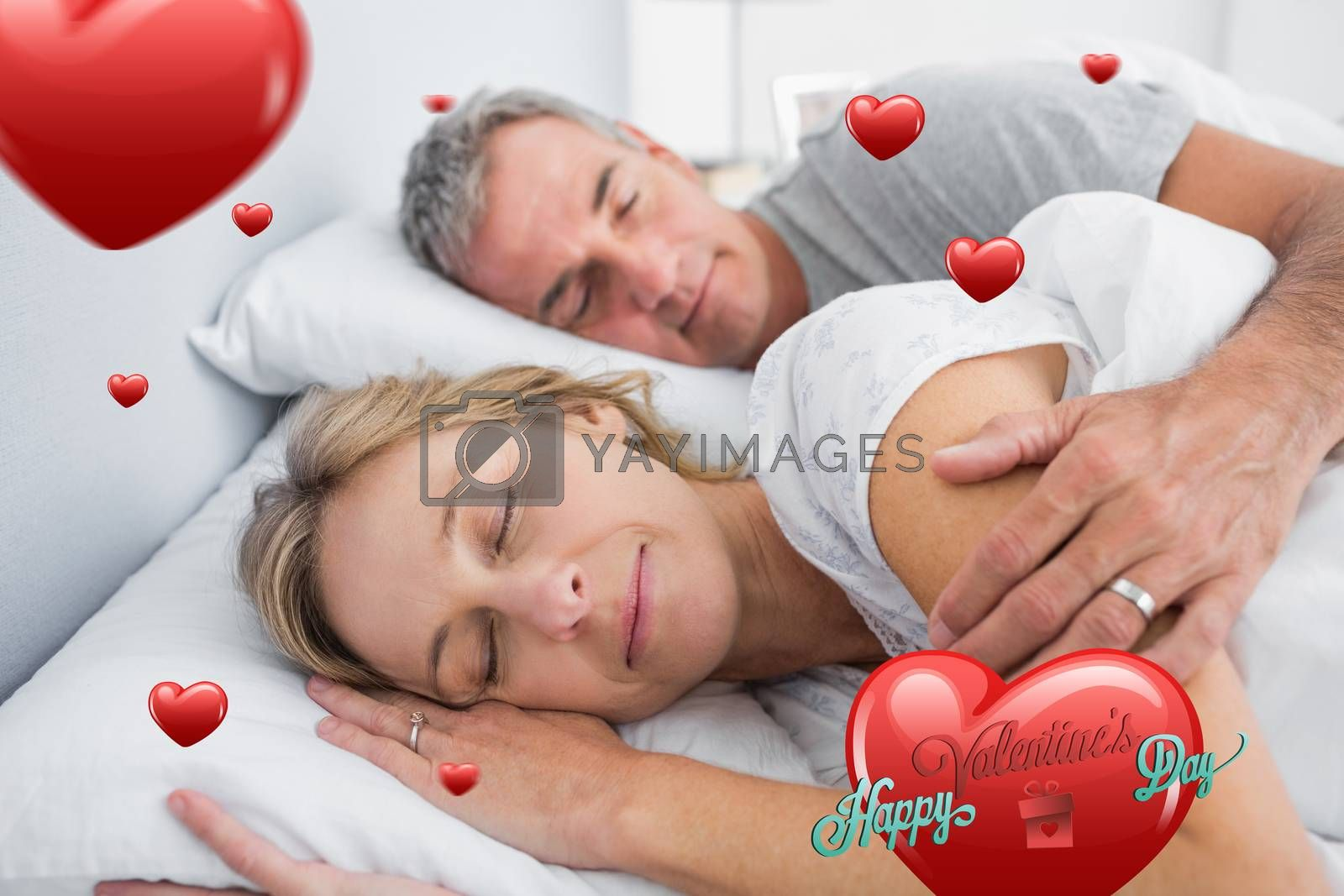 Couple sleeping and spooning in bed against happy valentines day