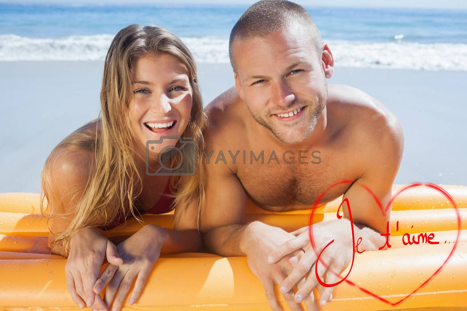 Happy cute couple in swimsuit posing against valentines love hearts