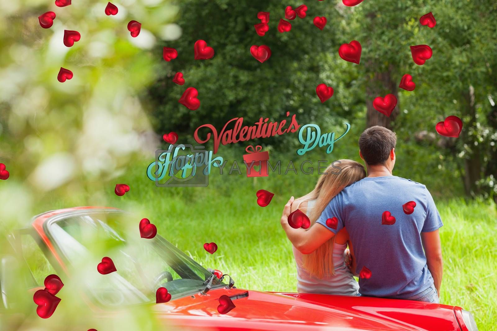 Loving couple admiring nature while leaning on their cabriolet against happy valentines day