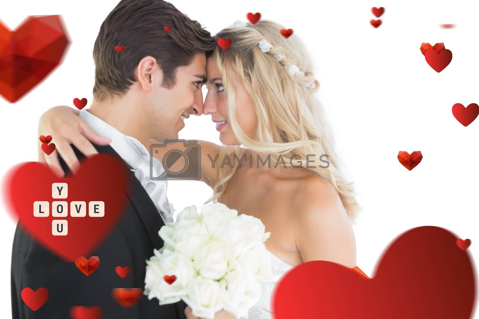 Beautiful young married couple looking each other in the face against love you tiles