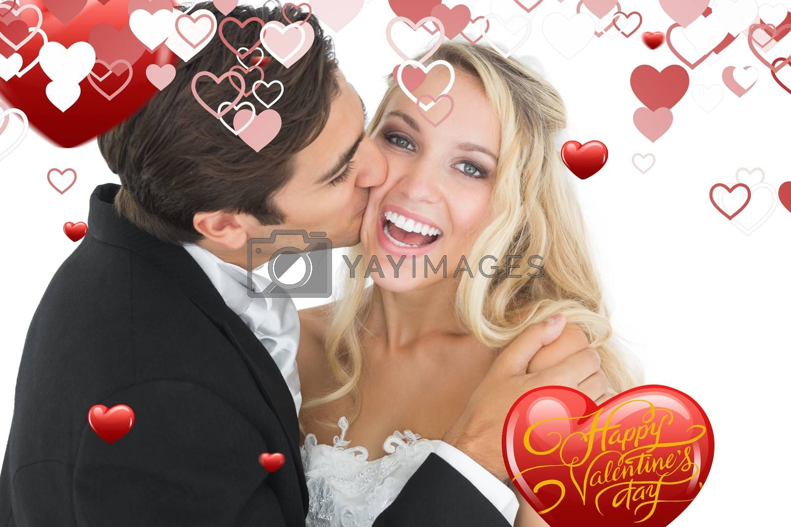 Handsome bridegroom kissing his wife on her cheek against happy valentines day