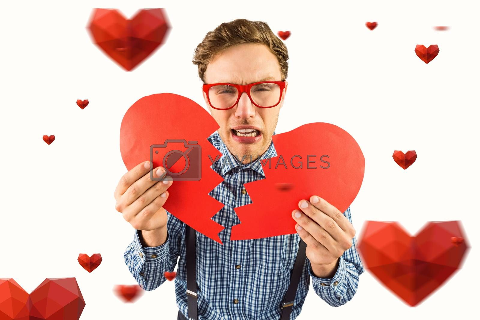 Geeky hipster holding a broken heart  against hearts