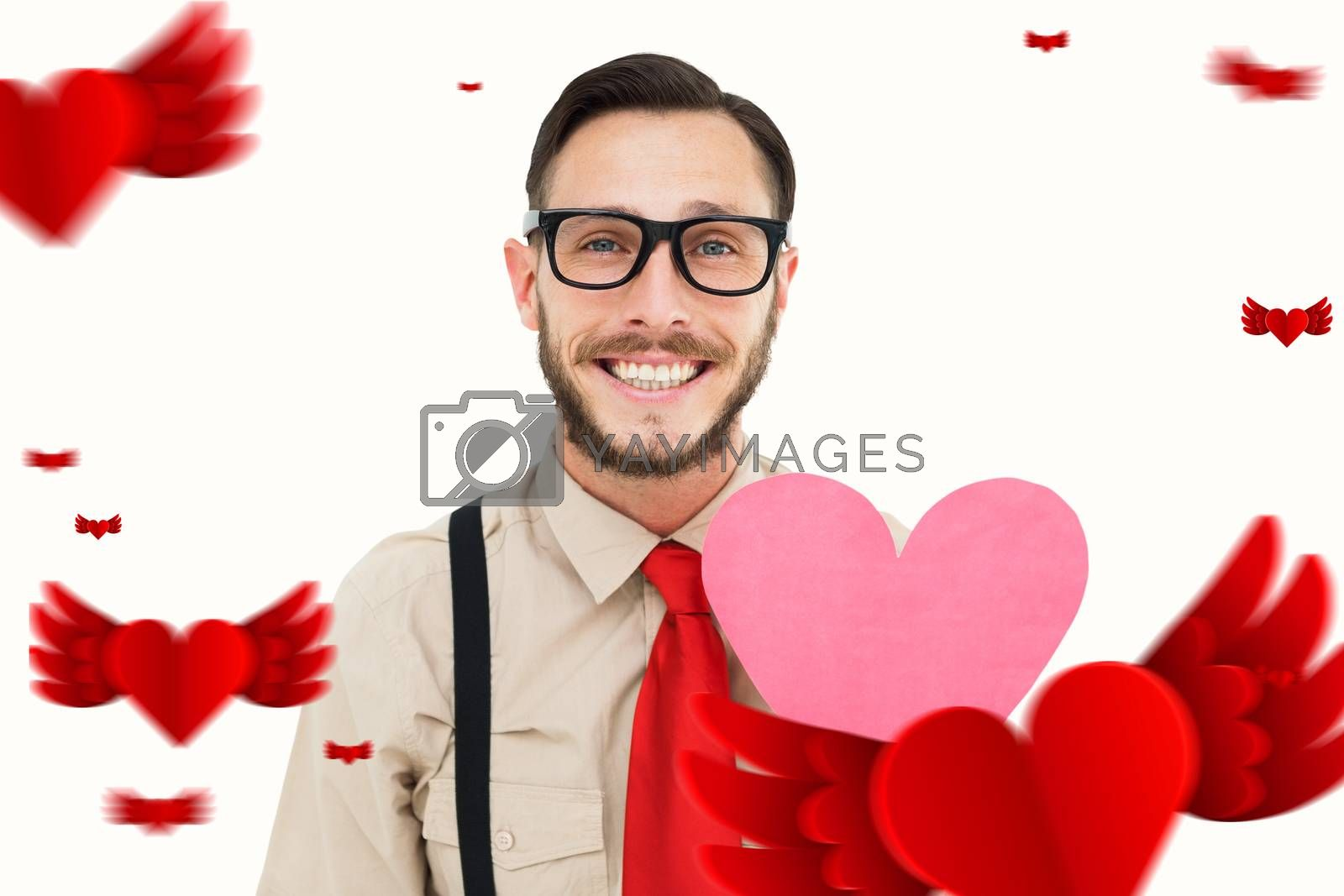 Geeky hipster smiling and holding heart card against hearts