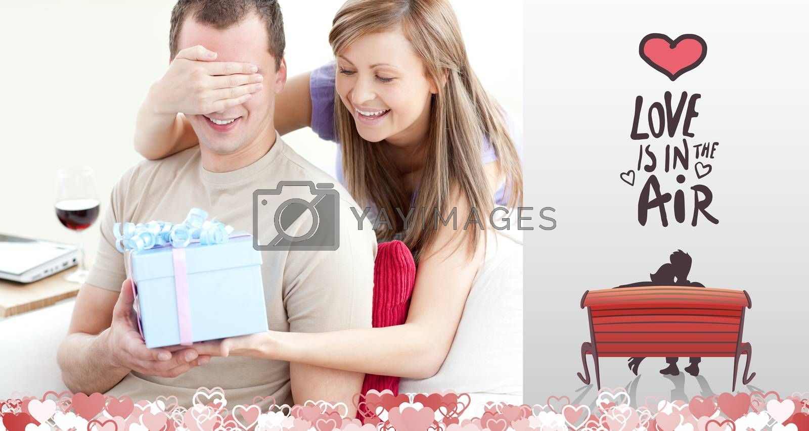 Smiling woman giving a present to her boyfriend against love is in the air