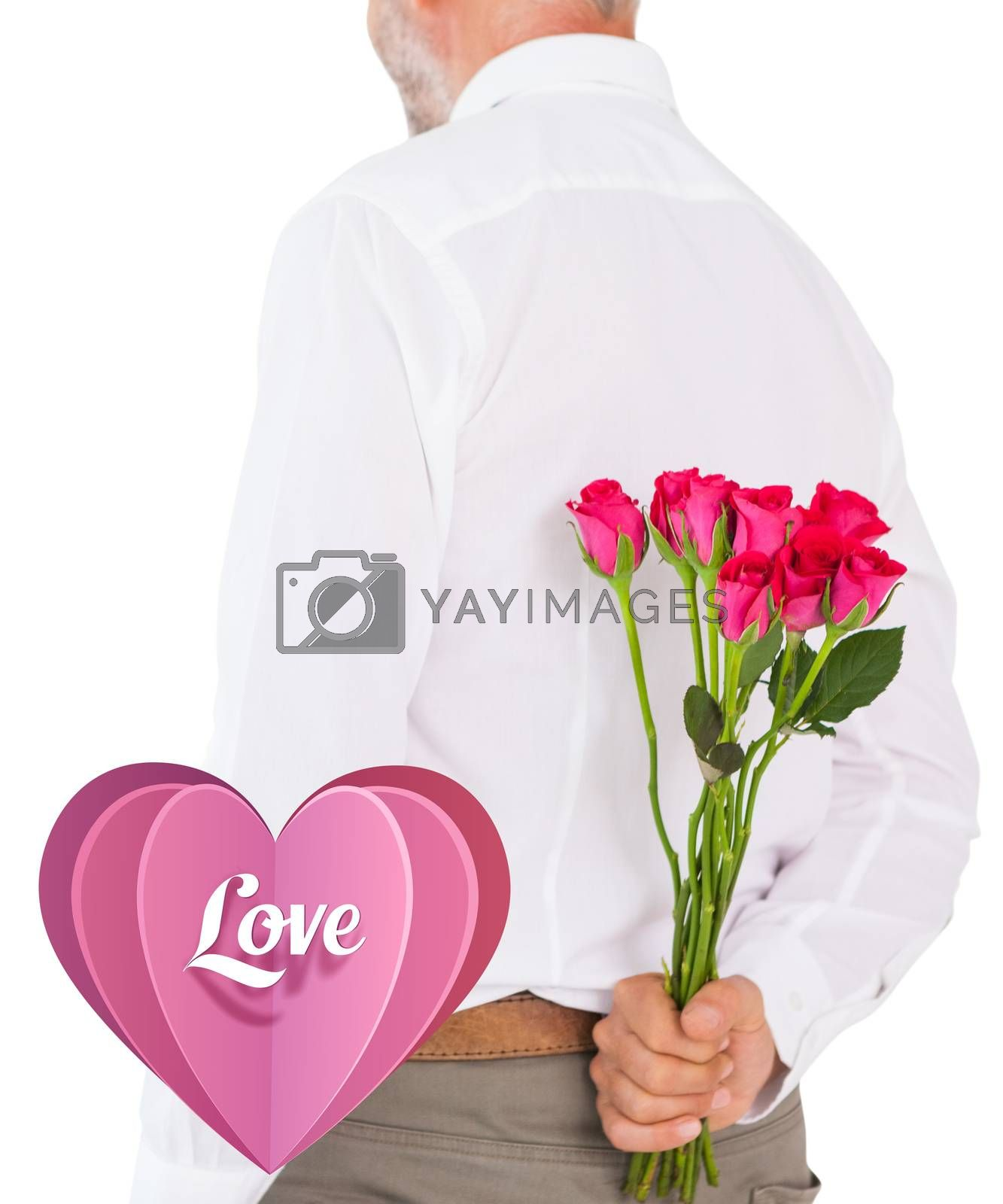 Man holding bouquet of roses behind back against love heart