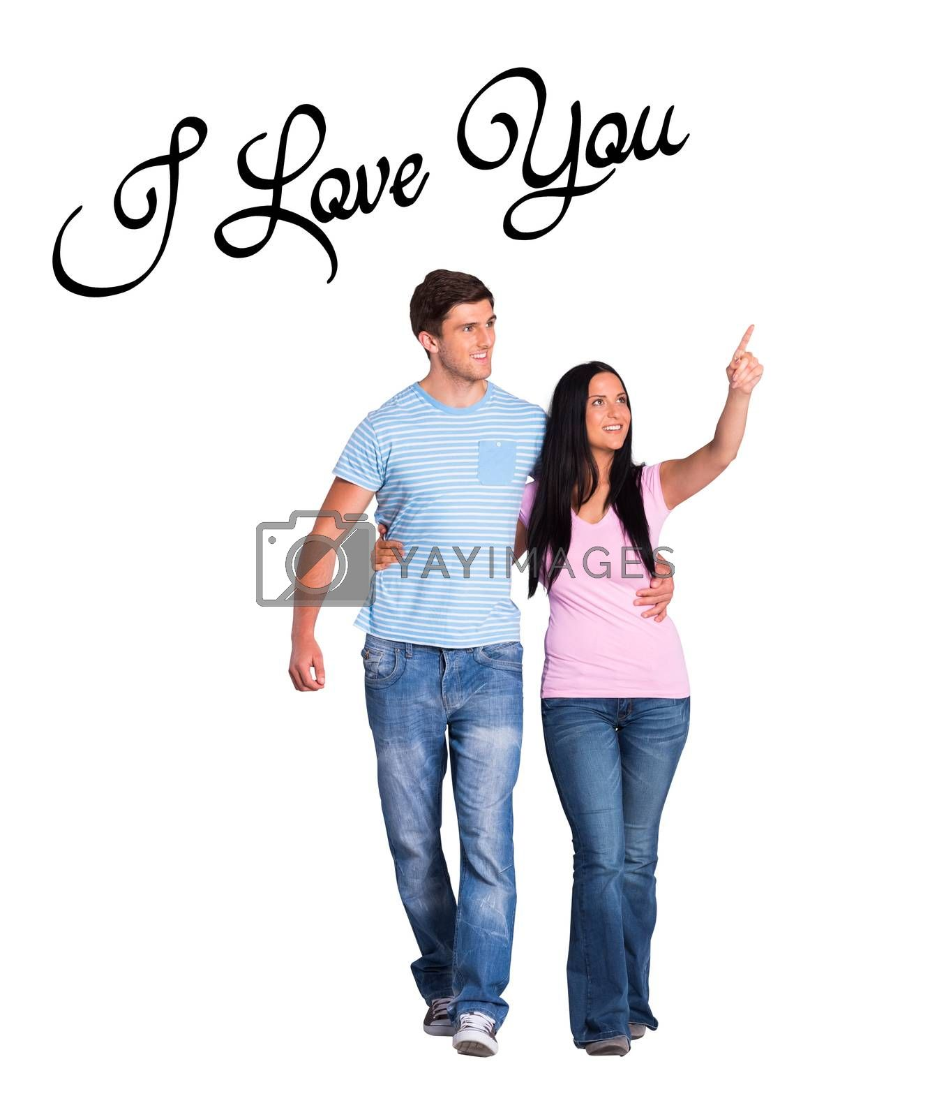Young couple walking and pointing against i love you