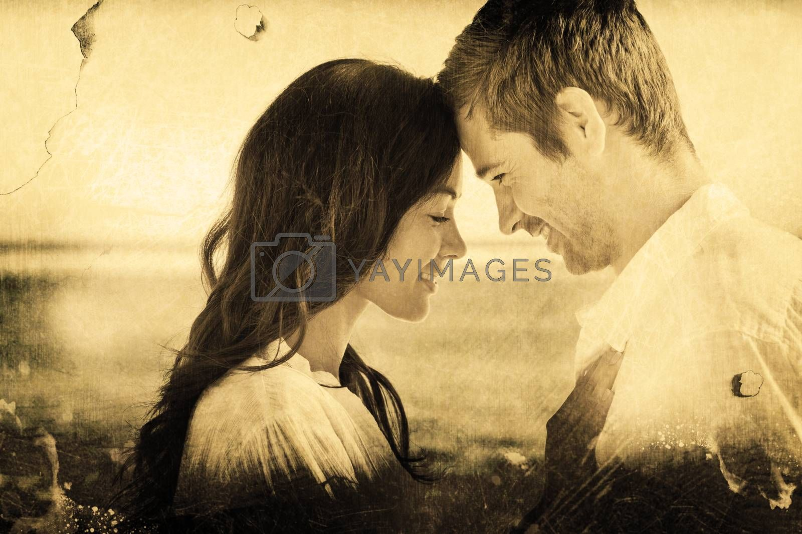 Romantic couple relaxing and embracing on the beach  against grey background