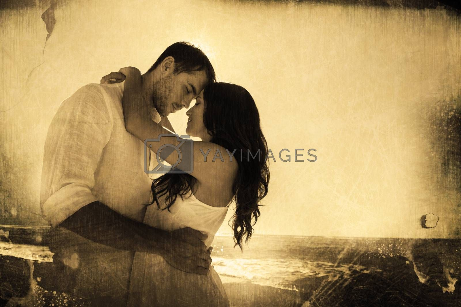 Romantic couple embracing  against grey background