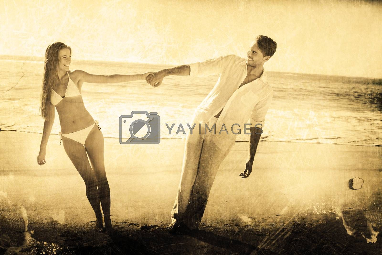 Couple holding hands and leaning to either side against grey background