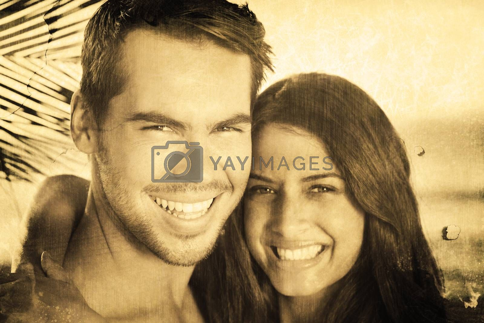 Cheerful loving couple having holidays against grey background
