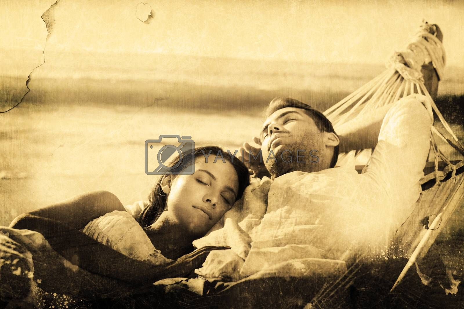 Peaceful couple napping in a hammock against grey background
