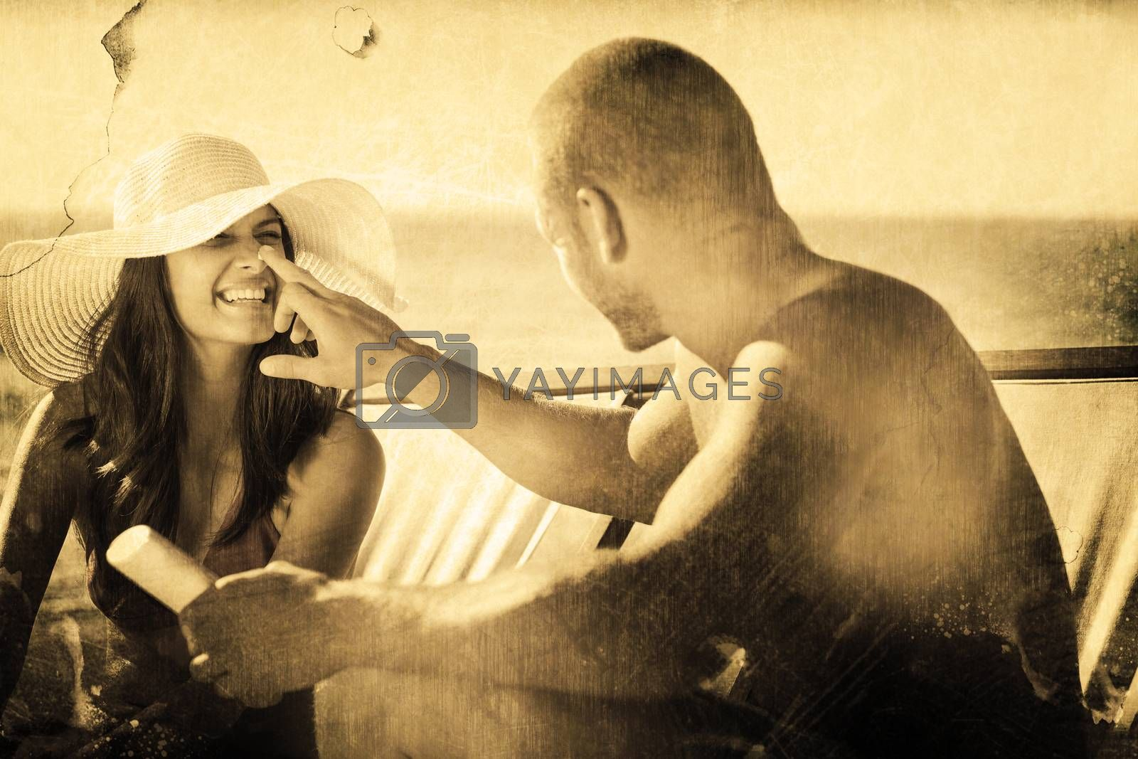 Handsome man applying sun cream on his girlfriends nose against grey background