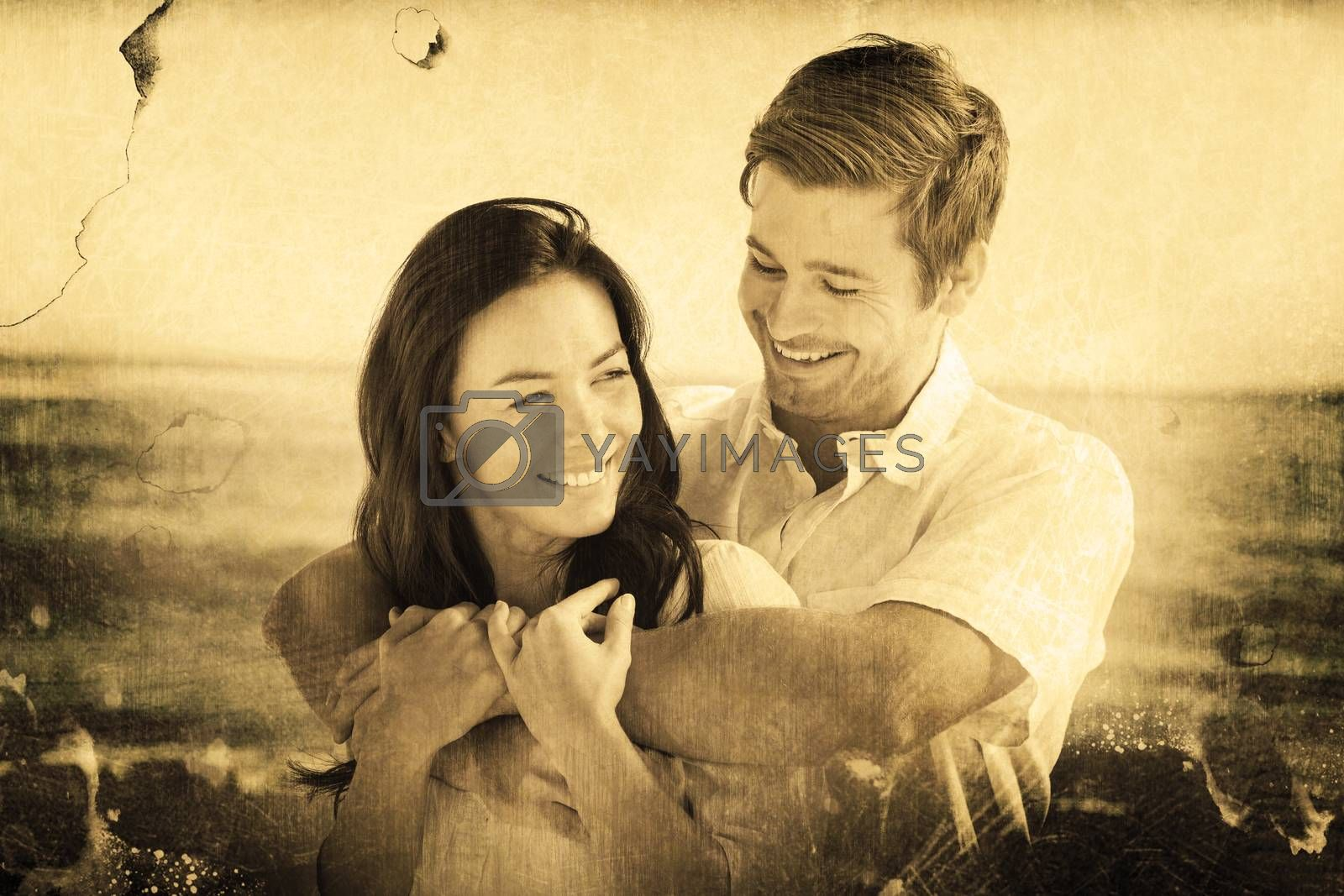 Cheerful couple relaxing on the beach during summer against grey background