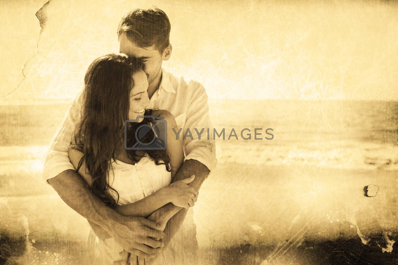 Loving couple cuddling against grey background