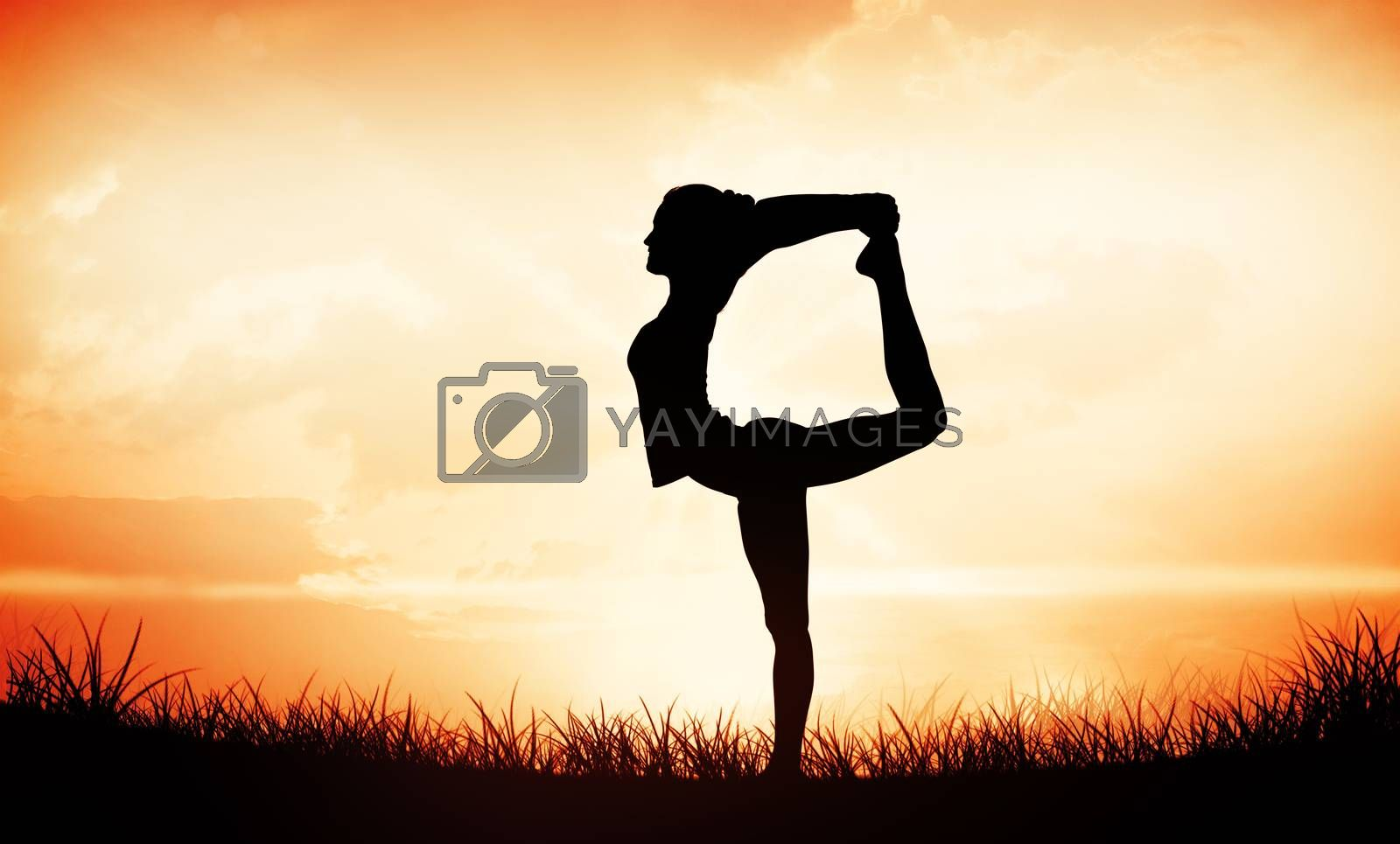 Sporty woman stretching body while balancing on one leg against orange sunrise