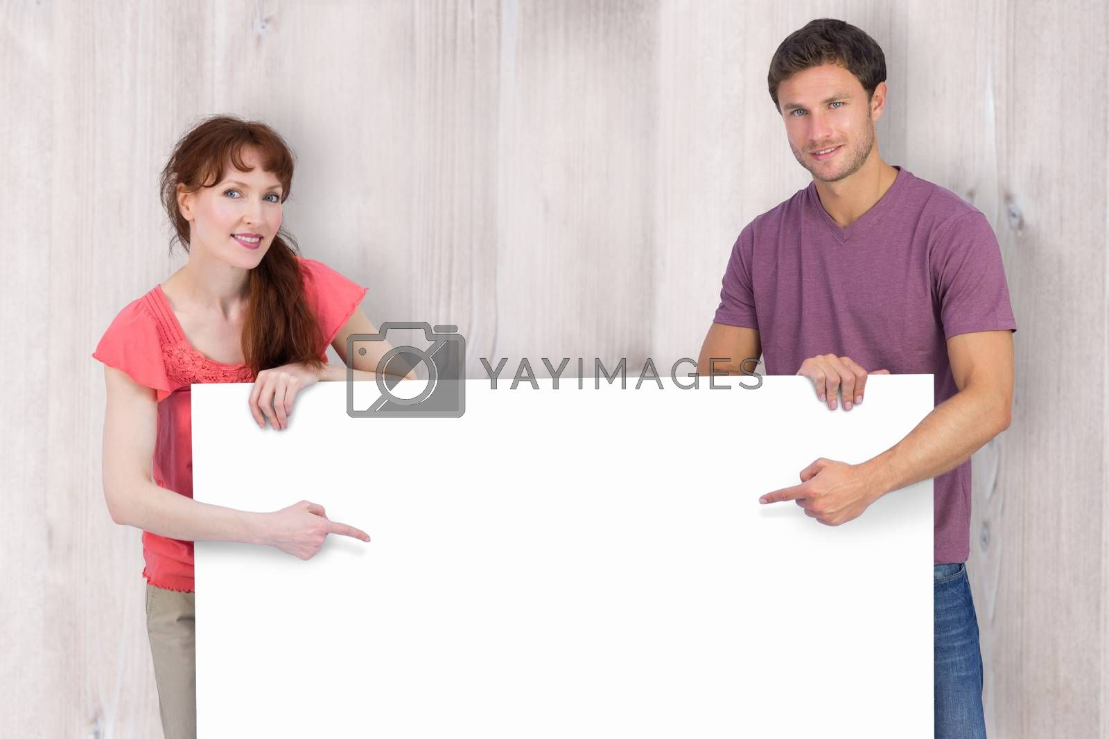 Couple looking at the camera against wooden planks