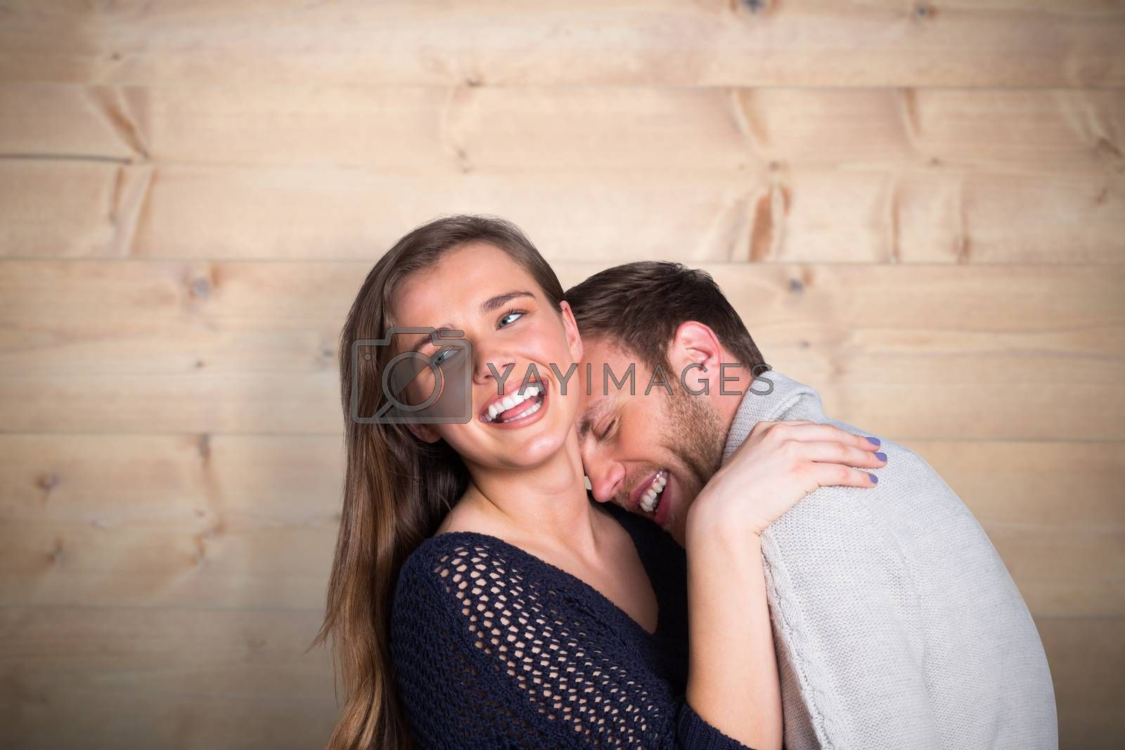 Close up of happy young couple against bleached wooden planks background