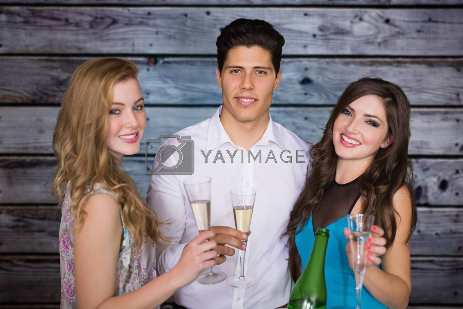 Friends drinking champagne against grey wooden planks
