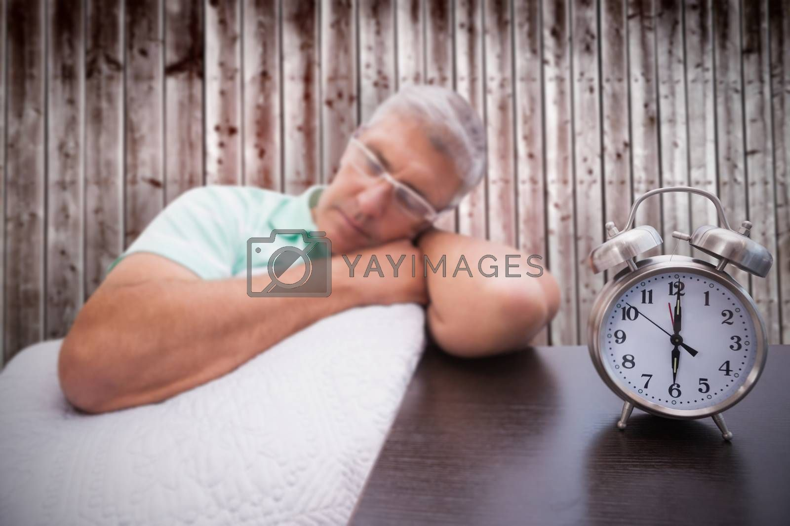 Man napping on couch against wooden planks