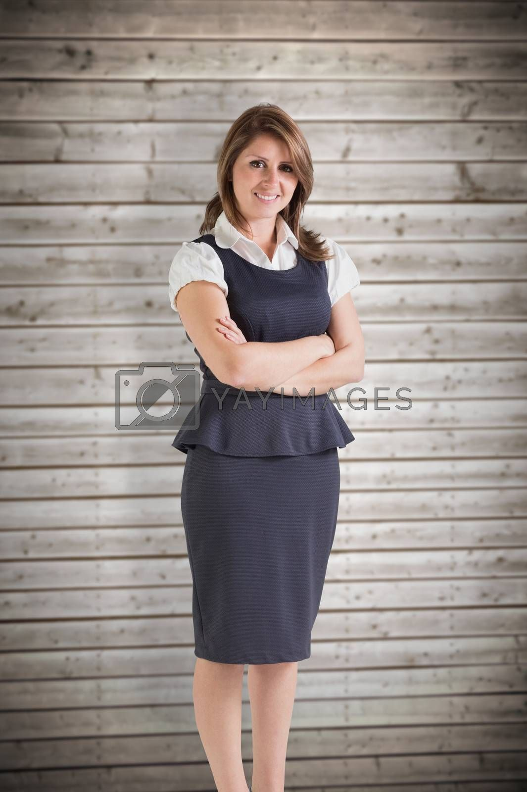 Happy businesswoman against wooden planks background