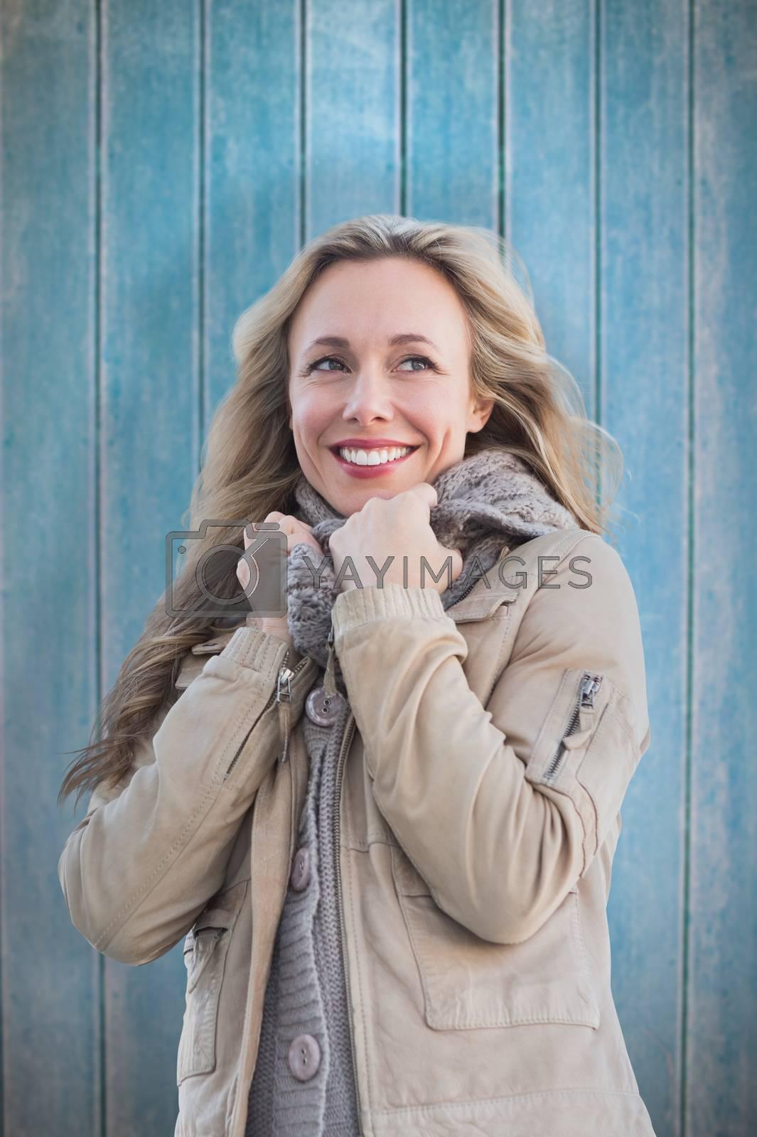 Smiling blonde against wooden planks