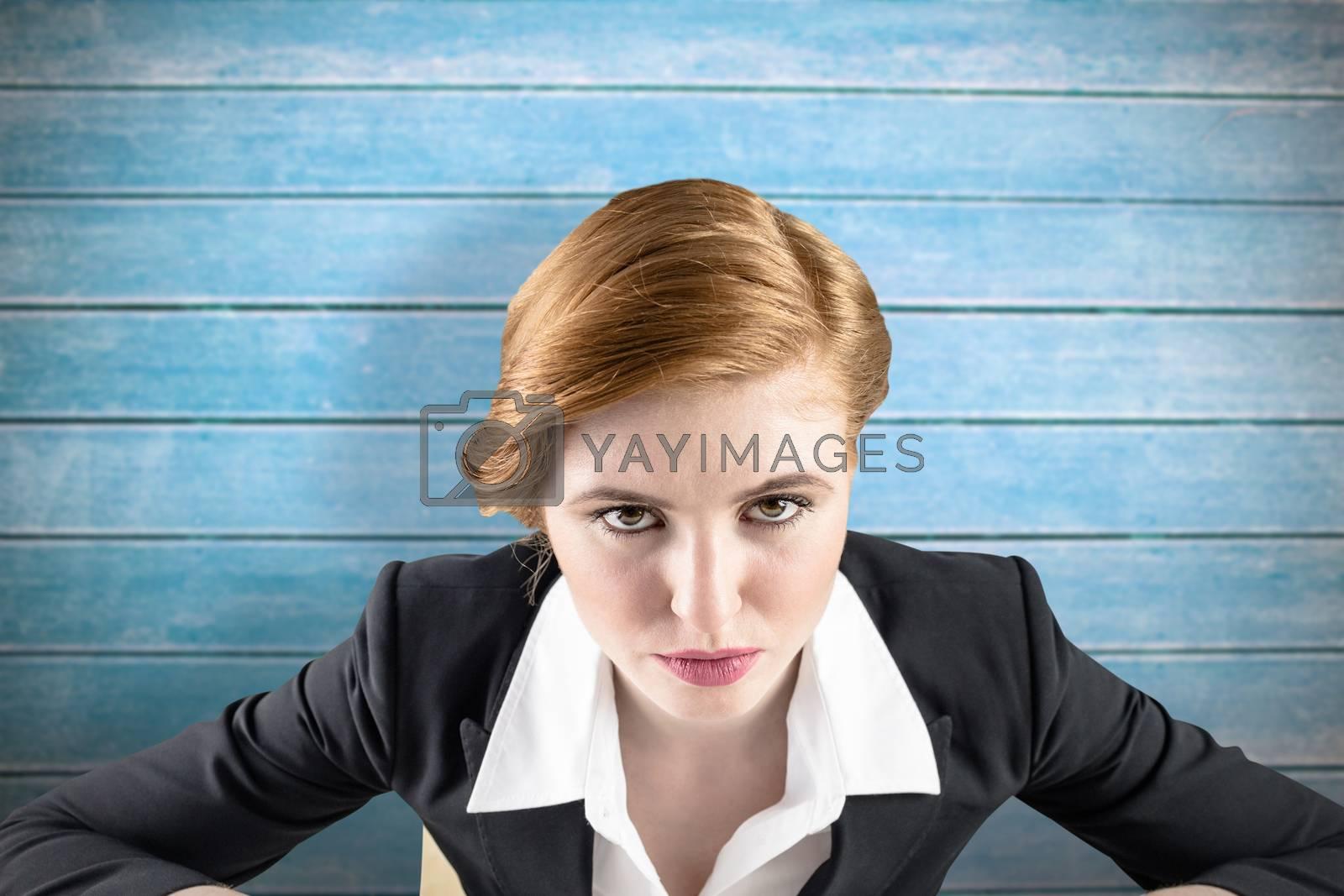 Focused businesswoman against wooden planks